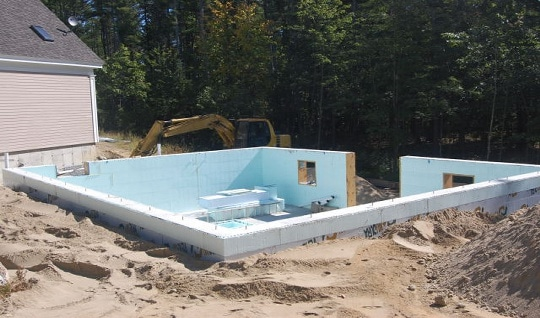 The foundation has been backfilled with appropriate drainage sand and is ready to be decked over. With the exception of the radiant floor heat and pouring the basement floor this entire project was completed by Mark Hawkes Forestry and Construction.
