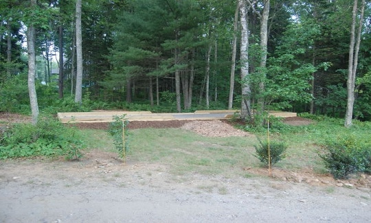 This is a Bocce Court we built for a homeowner. Steel rods anchor a course of timber below grade.